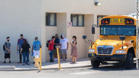 A teacher is suing an Arizona school district for implementing a mask mandate despite governor's ban