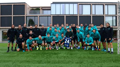 Eriksen with Inter teammates and staff at Appiano Gentile.