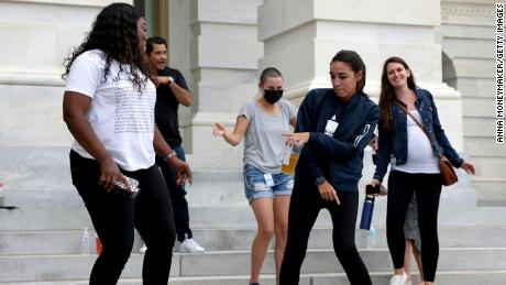 Rep. Cori Bush is joined by Rep. Alexandria Ocasio-Cortez at right, as they dance in celebration near the entrance to the Capitol Building on Tuesday.