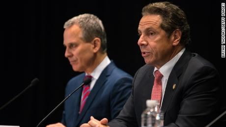 New York Gov. Andrew Cuomo issues an executive order putting state Attorney General Eric Schneiderman (n charge of investigating allegations of police abuse at John Jay College on July 8, 2015, in New York City.