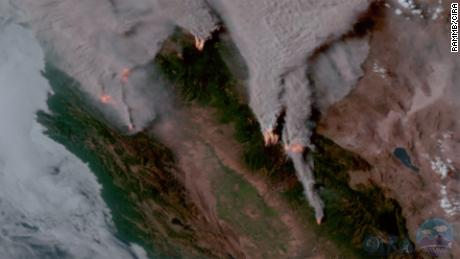 Several large wildfires and the smoke they're producing in Northern California were captured using a sensor aboard NOAA's GOES-West satellite to depict the fire temperature (red color) and natural color of the surrounding area.