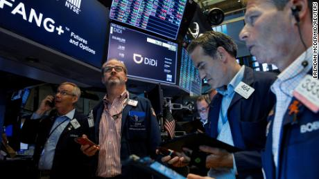 Traders work during the IPO for Chinese ride-hailing company Didi Global on the New York Stock Exchange.