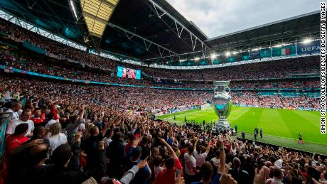 A large inflatable version of the trophy is seen on the pitch before the UEFA Euro 2020 Championship Final between Italy and England at Wembley Stadium on July 11, 2021.