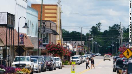 Two women walk across a street in downtown Oneonta on June 30, 2021, in Oneonta, Alabama.