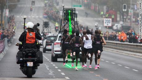 Kipchoge, in the white vest, is accompanied by pacemakers as he attempts to break the two-hour barrier for a marathon.