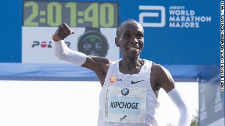 Kipchoge celebrates setting a world record at the 2018 Berlin Marathon.