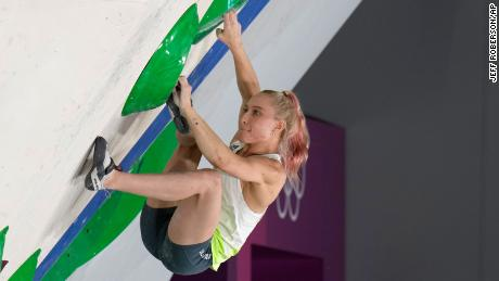 Garnbret competes in the bouldering element of the women's sport climbing final.