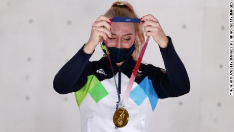 Garnbret poses with her gold medal at the Tokyo Olympics.