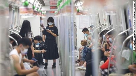 People wear face masks on the subway amid the Delta variant outbreak on July 27 in Nanjing, Jiangsu Province of China.