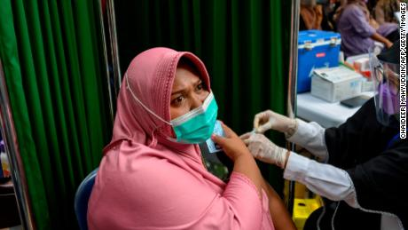 A woman receives a Sinovac vaccine in Banda Aceh, Indonesia. With less than 8% of its population fully vaccinated, Indonesia has overtaken India as Asia's new covid epicenter.