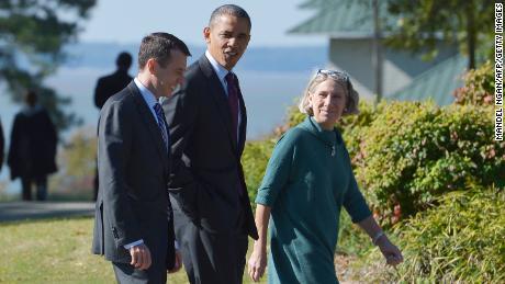 Then-President Barack Obama walks with senior White House adviser David Plouffe, left, and Dunn to debate preparation in 2012.