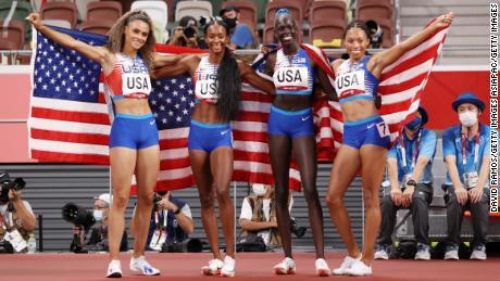 Team USA celebrates the relay win at Tokyo 2020.