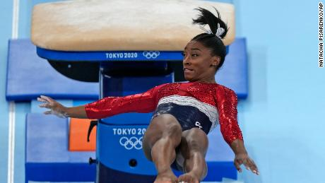Simone Biles performs on vault during the women's final in Tokyo