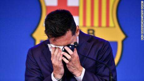 Messi cries during his farewell press conference at the Camp Nou on August 8.