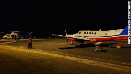 Royal Flying Doctors prepare to airlift two men who were attacked by a crocodile late on Friday, in Lockhart River, Queensland, Australia August 6, 2021.