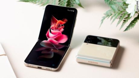 The Galaxy Z Flip3, which opens and closes vertically, comes with a thinner hinge and redesigned cover screen that is four times larger than the previous model.