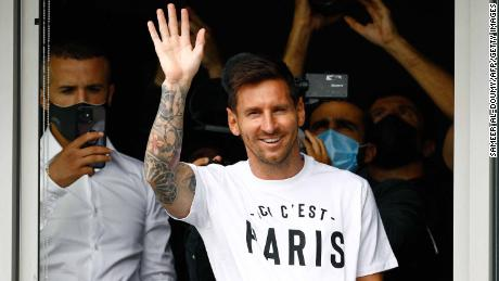 Messi waves to supporters from a window after he landed in Paris on August 10, 2021.