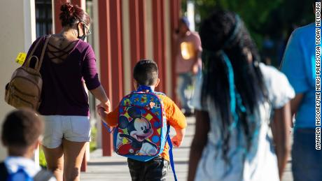 Parents of Tice Elementary School students drop their kids off for the first day of school in Fort Myers, Florida, on August 10, 2021.