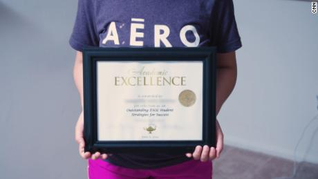 Montserrat holds an academic excellence award she won at her school in 2019.
