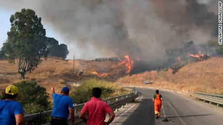 Volunteers try to control fire in the Municipality of Blufi near Palermo, Sicily, Italy.