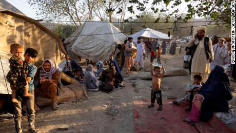 Displaced Afghans arrive at a makeshift camp in Kabul on  August 10, 2021.