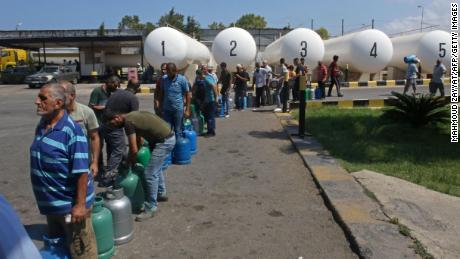 Lebanese wait to fill their gas cylinders in the southern city of Sidon, on August 10.