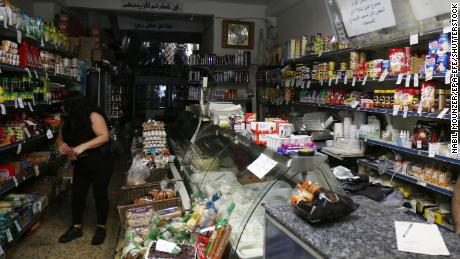 A woman shops in a store without electricity due to shortages in Beirut on August 11.