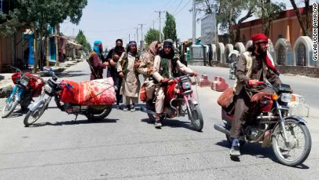 Taliban fighters are shown patrolling the city of Ghazni on Thursday.