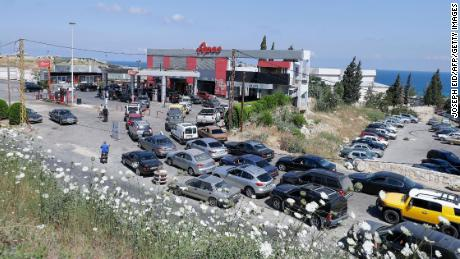 Vehicles line up at a petrol station in the Balamand area on the coastal highway linking Lebanon's capital to the country's north, on June 21, 2021 amid dire fuel shortages.