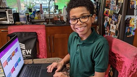 Shun Jester, 10, is comfortable on computers and likes virtual learning.