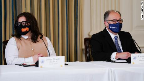 Jess Morales Rocketto, civic engagement director of the National Domestic Workers Alliance, (left), and Ramiro Cavazos, president and CEO of the US Hispanic Chamber of Commerce, listen as President Joe Biden speaks during a meeting with Latino leaders in the White House on August 3, 2021.