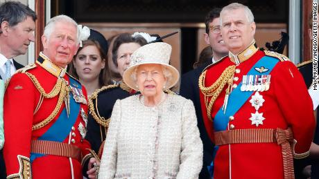 The Queen stands with Princes Charles and Andrew during a flypast of Buckingham Palace in 2019.