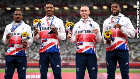 Team GB 4x100m relay athletes pose with their silver medals at the Tokyo Olympics.