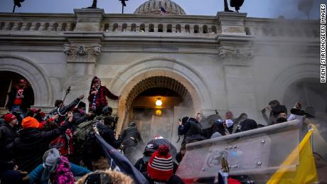 Trump supporters clash with police and security forces as they try to storm the US Capitol on January 6, 2021 in Washington.