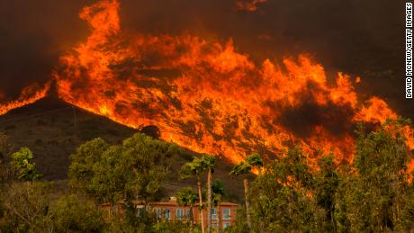 The Woolsey Fire approaches homes on November 9, 2018 in Malibu, California.