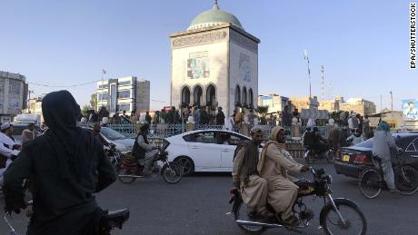 Taliban militants gather a day after taking control of Kandahar on August 14.