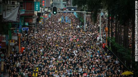 Demonstrators march during the Civil Human Rights Front march in Wan Chai, Hong Kong, on Sunday, July 21, 2019.