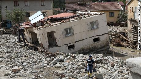 A drone photo shows  Babacay village after flooding caused by heavy rains in the Ayancik district of Sinop, Turkey, on Saturday.