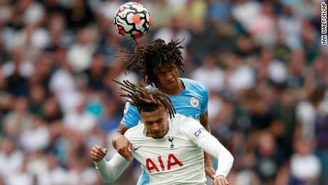 Manchester City's Nathan Ake, top, jumps for the ball with Tottenham's Dele Alli.