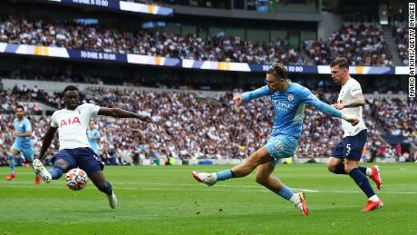 Manchester City's Jack Grealish shoots during the Premier League match against Tottenham Hotspur.
