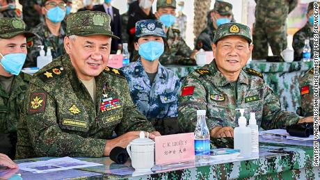 Russian Defense Minister Sergei Shoigu and Chinese Defense Minister Wei Fenghe watch a joint military exercise by Russia and China held in the Ningxia Hui Autonomous Region in northwestern China on Friday.