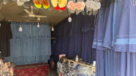 Burqas hang in a market in Kabul on July 31. The price has surged as women rush to cover themselves to avoid attracting the militants' attention.