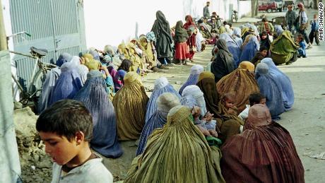 Women huddle outside the UN offices in Kabul seeking help in January, 1999.
