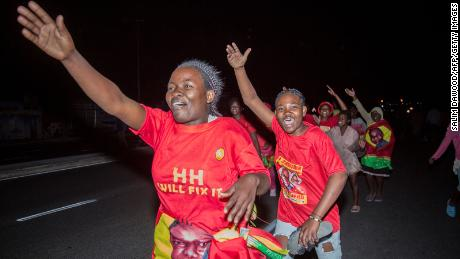 Supporters of presidential opposition candidate Hakainde Hichilema celebrate his election as Zambian President in Lusaka.