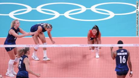 Justine Wong-Orantes (in red) celebrates with teammates during the women's volleyball semifinal between the United States and Serbia on August 6, 2021.