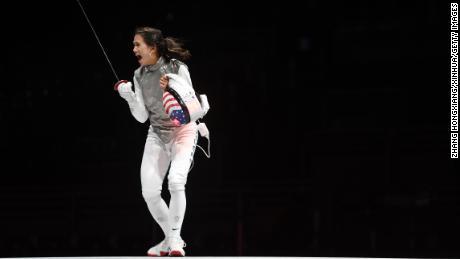 Lee Kiefer celebrates winning the women's foil individual gold medal bout against Inna Deriglazonva of the ROC on July 25, 2021.