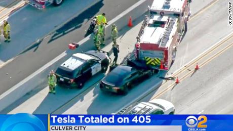 This Jan. 22, 2018, file photo shows a Tesla Model S electric car that has crashed into a fire engine on Interstate 405 in Culver City, Calif. This is one of 11 accidents involving Tesla vehicles using Autopilot and emergency vehicles.