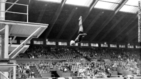 Vicki Draves straightens up as she plunges towards the water on her way to winning diving gold at the London Olympic Games in 1948.