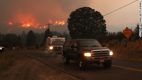 Residents evacuate as the Dixie fire burns into a neighborhood on near Janesville, California.