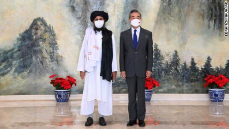 Taliban co-founder Mullah Abdul Ghani Baradar, left, and Chinese Foreign Minister Wang Yi in China on July 28, 2021.